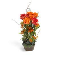 Vackert arrangemang i orange